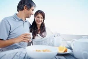 Happy mature couple having healthy breakfast in morning